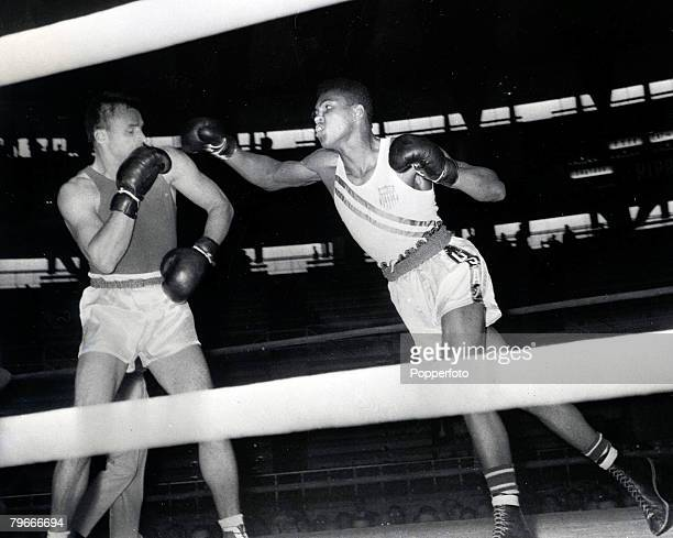 Olympic Games, Rome, Italy, Boxing, Cassius Clay of the USA punches Gennadiy Shatov of the Soviet Union whom he beat on a unanimous points victory to...