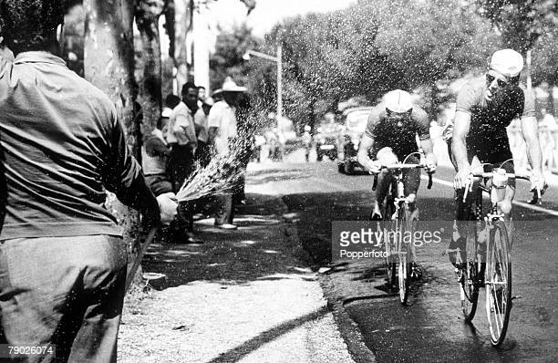 Olympic Games Rome Italy Cycling Road Race Dutch riders Hugens and Van Krennigen get a drink from a hosepipe