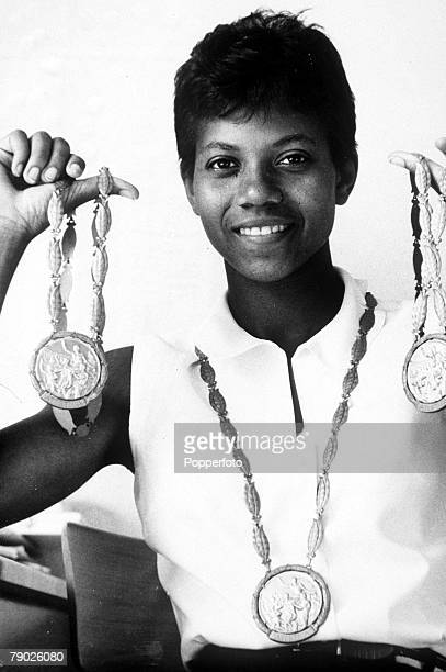 Olympic Games Rome Italy Cycling USA's Wilma Rudolph hold her three gold medals which she won in the Women's 100 Metres 200 Metres and 4 x 100 Metres...