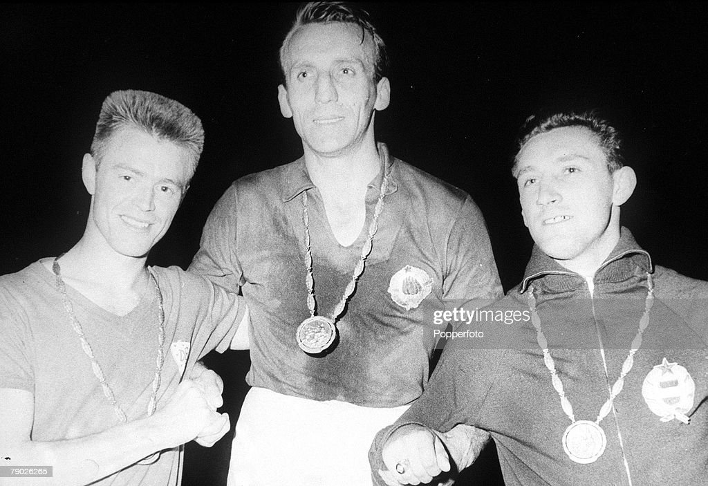1960 Olympic Games. Rome, Italy. Football captains L-R: Denmark's Jenson , whose team won the silver medal, Yugoslavia's Kostic (gold) and Hungary's Varhidi (bronze). : Nachrichtenfoto