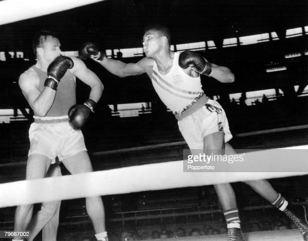 Olympic Games Rome Italy Light Heavyweight Boxing USA's Cassius Clay jabs at USSR's Gennadiy Shatov who he beat on a unanimous points victory to win...