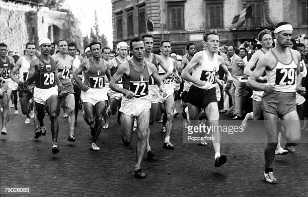 Olympic Games Rome Italy Marathon Holland's Kunen leads a crowd of runners at the start of the race R