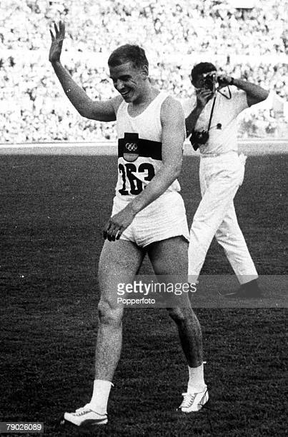 Olympic Games Rome Italy Men's 100 Metres Final German gold medal winner Armin Hary waves to the crowd after the race