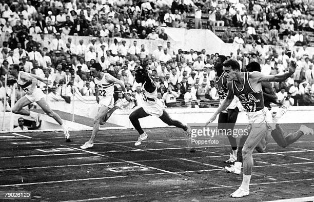Olympic Games Rome Italy Men's 100 Metres Final West Germany's Armin Hary crosses the line to take the gold medal ahead of USA's silver medallist...