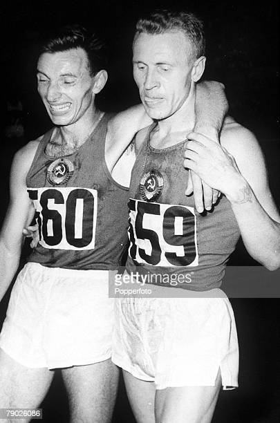 Olympic Games Rome Italy Men's 10000 Metres Final USSR's gold medal winner P Bolotnikov with E Zhokov after the race