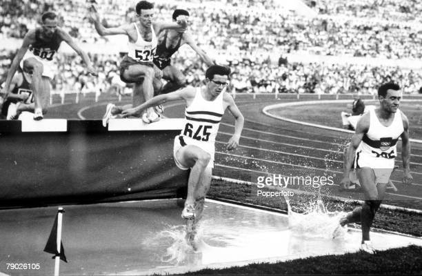 Olympic Games Rome Italy Men's 3000 Metres Steeplechase Great Britain's D Chapman at the water jump with Germany's Ludwig Muller