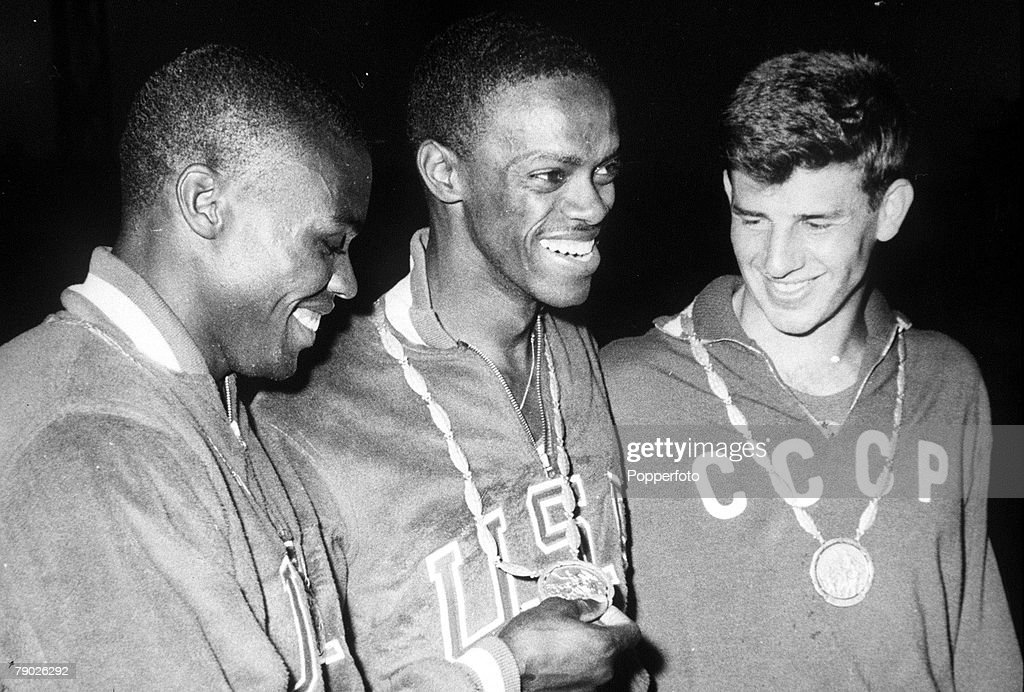 1960 Olympic Games. Rome, Italy. Men's Long Jump. USA's gold medal winner Ralph Boston displays his medal with silver medallist Irvin Roberson of the USA (L) and USSR's Igor Ter-Ovanesyan : News Photo