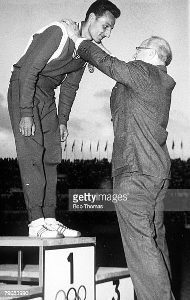 Olympic Games Rome Italy Mens Triple Jump Poland's Jozef Schmidt receives his Gold Medal from IOC President Avery Brundage