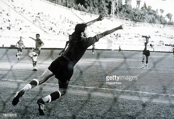 Olympic Games Rome Italy Soccer Brazil 5 v China 0 Brazil's R Dias Branco scores a goal past the Chinese goalkeeper