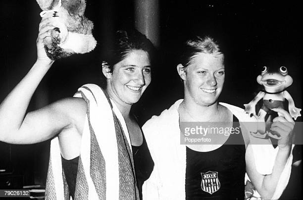 Olympic Games Rome Italy Swimming Women's 100 Metres Freestyle Australian gold medal winner Dawn Fraser celebrates with USA's silver medallist...
