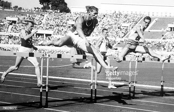 Olympic Games, Rome, Italy, Track and Field, Men's 400 Metres Hurdles Heat, Eventual gold medal winner Glenn Davis of the USA in action to win the...