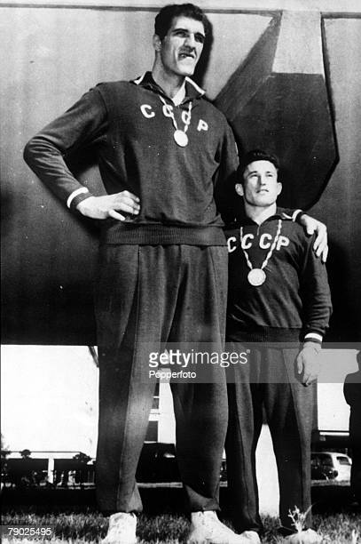 Olympic Games Rome Italy USSR's Krumich left who seven feet tall with E Minaev the tallest and shortest athletes at the 1960 Games