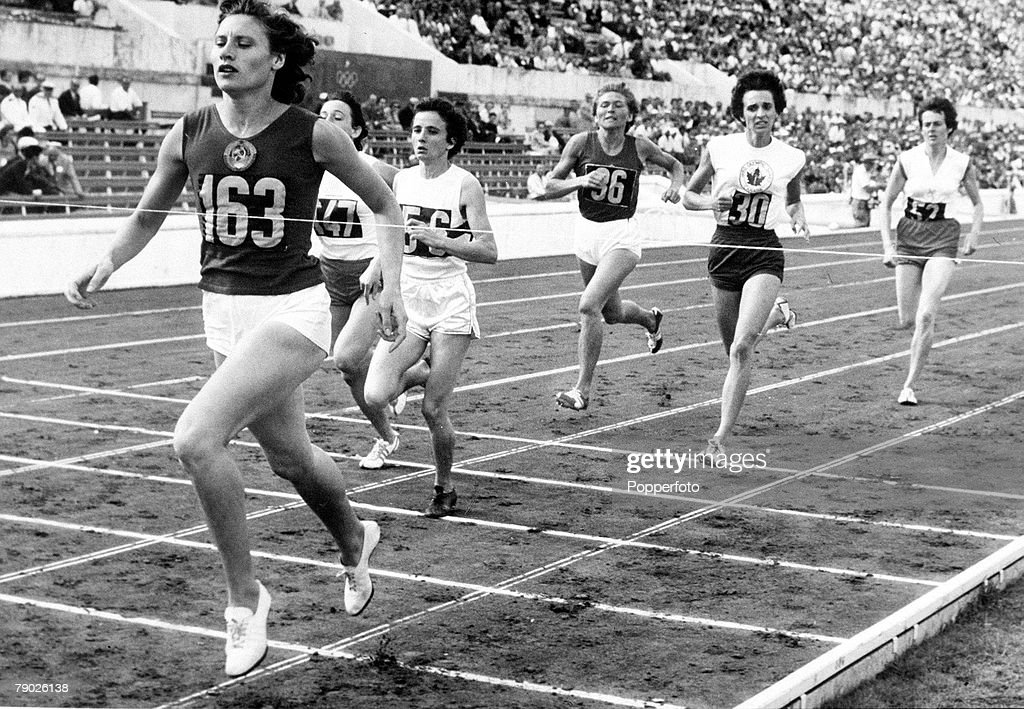 Olympic Games, Rome, Italy, Women's 800 Metres Heat, USSR's eventual gold medal winner Lyudmila Shevtsova crosses the line to win the race ahead of Hungary's Gizella Csoka (56) and Poland's Beata Zbikowska