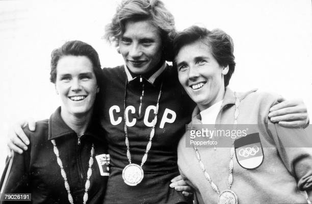 Olympic Games Rome Italy Women's 800 metres USSR's gold medal winner Lyudmila Shevtsova stands with Australian silver medallist Brenda Jones and...