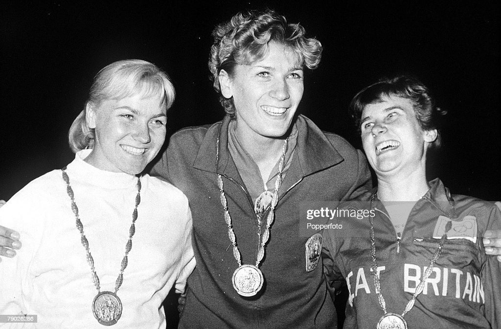 1960 Olympic Games. Rome, Italy. Women's High Jump. Romanian gold medal winner Iolanda Balas (C) wears her medal as she stands with Polish silver medallist Jaroslawa Jozwiakowska (L) and great Britain's Dorothy Shirley who won bronze. : News Photo