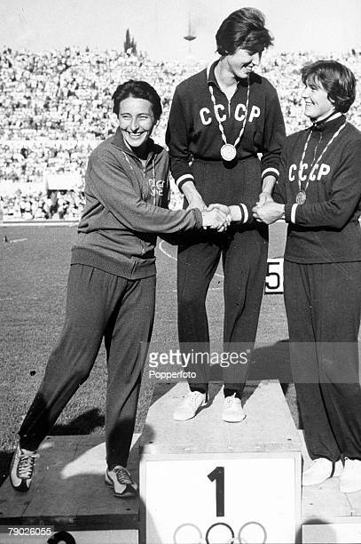 Olympic Games Rome Italy Womens Javelin USSR's Gold Medal winner Elvira Ozolina stand on the podium with Czechoslovakia's Silver Medalist Dana...