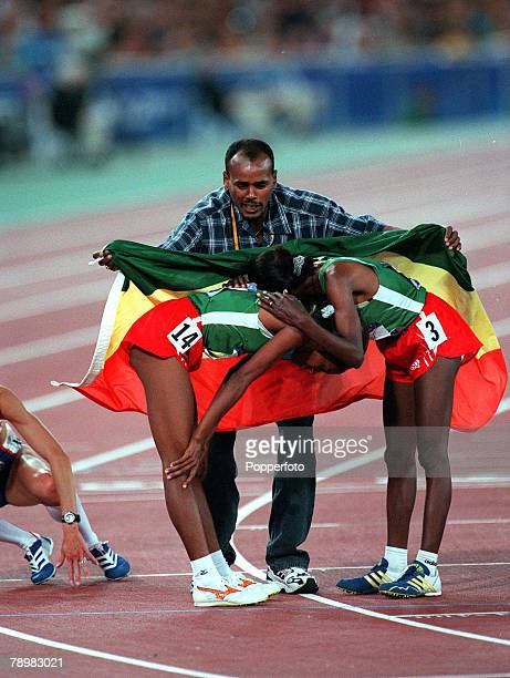 Olympic Games Sydney Australia Athletics Women's 10000m Final 25th September Derartu Tulu celebrates Goldwith Gete Wami who won Silver get covered in...