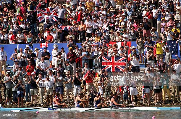 Olympic Games Sydney Australia Rowing Men's Coxless Fours Final 23rd September Members of the Great Britain gold medal winning team pass by a huge...