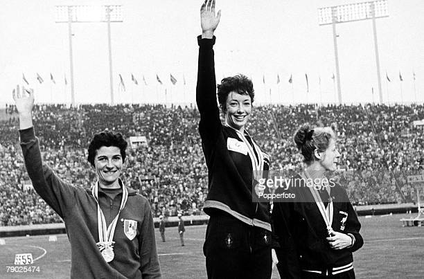Olympic Games Tokyo Japan Women's 800 Metres Final Great Britain's gold medal winner Ann Packer waves as she stands on the podium with France's...