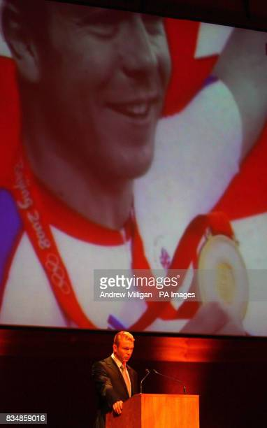 Olympic gold medal cyclist Chris Hoy during a medal ceremony where he and Minister for Schools and Skills Maureen Watt presented medals to more than...