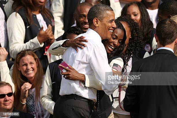S Olympic gold medal runner Dee Dee Trotter embraces US President Barack Obama during an event with members of the US Olympic and Paralympic teams at...