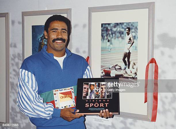 Olympic Gold medal winning decathlete Daley Thompson poses for a portrait with the first Allsport Visions of Sport book at the book launch exhibition...