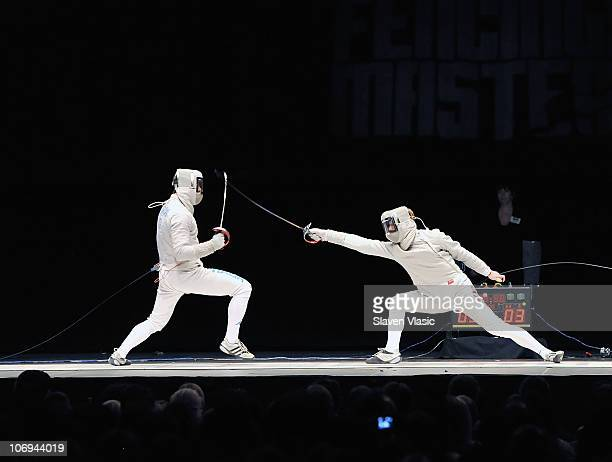 Olympic Gold medalist Aldo Montano from Italy and Daniel Bak Team USA participate at the Fencing Masters NYC Tournament and Expo at the Hammerstein...