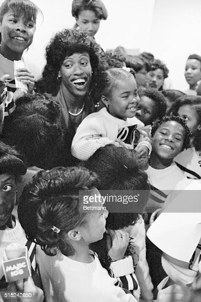 1988 Olympic gold medalist and St Louis area native Jackie JoynerKersee is mobbed by autograph seeking MathewsDickey Boys Club cheerleaders following...