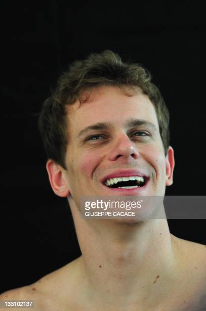 Olympic gold medalist and world record-holder Brazilian swimmer Cesar poses during a photo shooting session for his sponsor on November 16, 2011 in a...