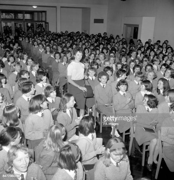 Olympic gold medalist Ann Packer arrives to a rapturous applause in the assembly hall at Coombe County Girl's School in Surrey She was officially...