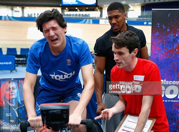 Olympic Gold Medalist Anthony Joshua of Great Britain watches over as a trialist takes part during the launch of the Discover Your Gold at Lee Valley...
