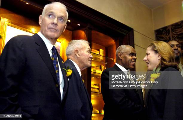 Olympic gold medalist Bill Toomey left listens to a conversation as three sport star Don Branby second from left talks with womens basketball...