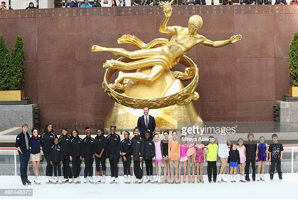 Olympic Gold Medalist Charlie White Meryl Davis and NYC Comapny President CEO Fred Dixon pose with young skaters from Figure Skating in Harlem and...