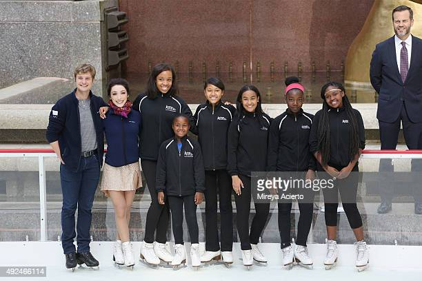 Olympic Gold Medalist Charlie White Meryl Davis the NYC Company President CEO Fred Dixon pose with young figure skaters from Figure Skating in Harlem...