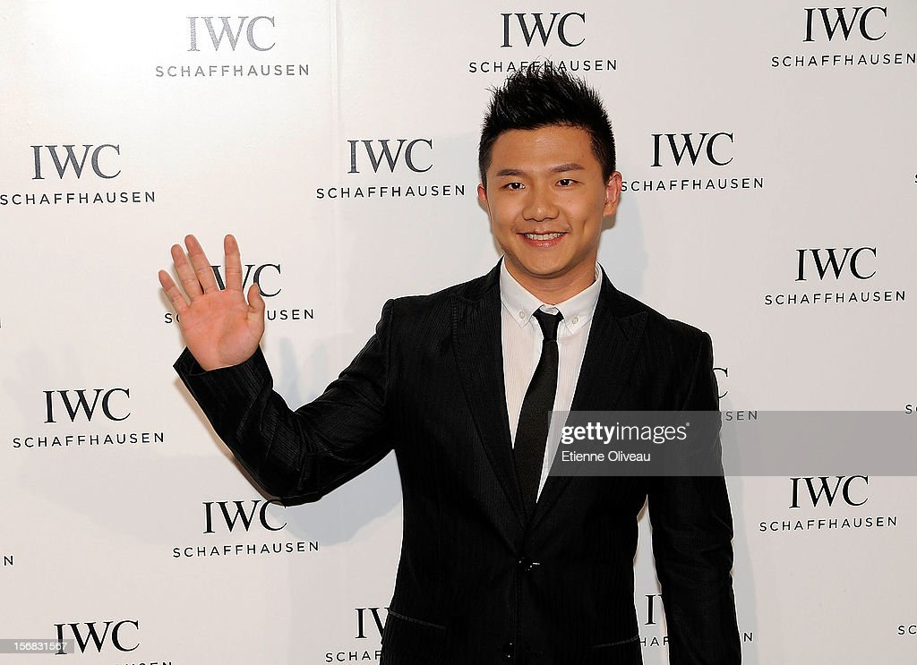 Olympic gold medalist Chen Yibing poses for photographs during the IWC Flagship Boutique Opening on November 22, 2012 in Beijing, China.