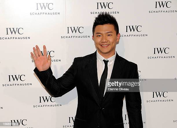 Olympic gold medalist Chen Yibing poses for photographs during the IWC Flagship Boutique Opening on November 22 2012 in Beijing China