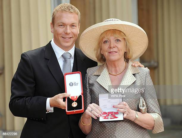 Olympic gold medalist Chris Hoy who was knighted and mother Carol Hoy who received an MBE outside Buckingham Palace after the investiture ceremony at...