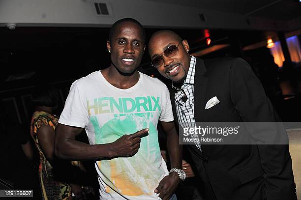 Olympic gold medalist Dwight Phillips and movie producer Will Packer attend the American Black Film Festival Atlanta Buzz Party at Luxe Ultra Lounge...