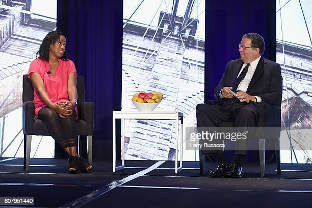 Olympic Gold Medalist for Track and Field Jackie JoynerKersee and EVP and Chief Diversity Officer for Comcast Corporation David L Cohen speak onstage...