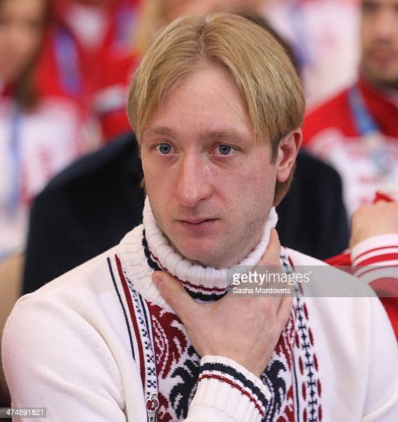 Olympic Gold medalist in figure skating Evgeni Plushenko adjusts his jumper during an awards ceremony for Russian Olympic athletes on February 24...
