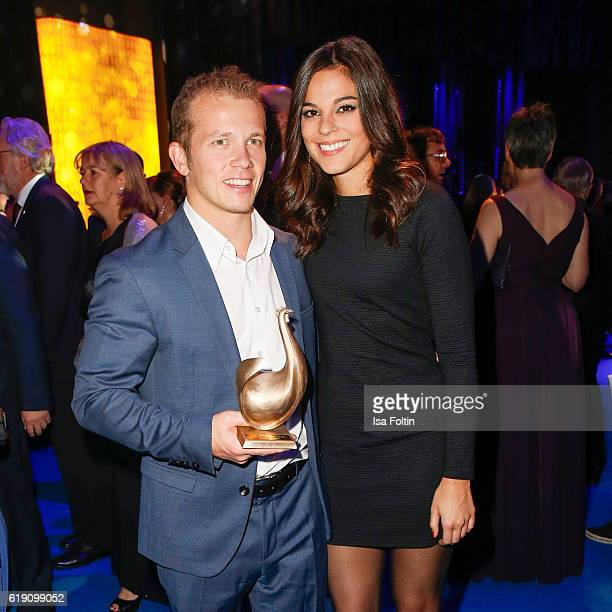 Olympic gold medalist in gymnast and Goldene Henne award winner Fabian Hambuechen and his girlfriend Marcia Ev during the aftershow party at the...