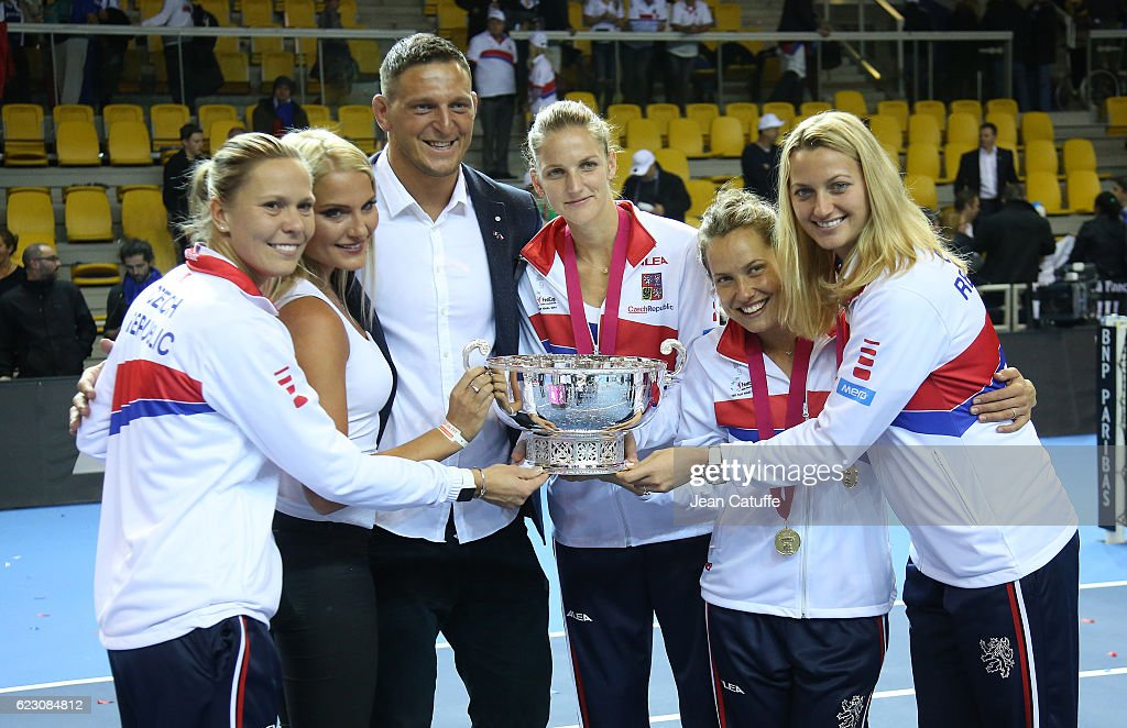 Olympic gold medalist in Rio Lukas Krpalek of Czech Republic in judo and his wife Eva Krpalekova pose with winners of the the Fed Cup Lucie Hradecka, Karolina Pliskova, Barbora Strycova and Petra Kvitova following the 2016 Fed Cup Final between France and Czech Republic at Rhenus Sport arena on November 13, 2016 in Strasbourg, France.