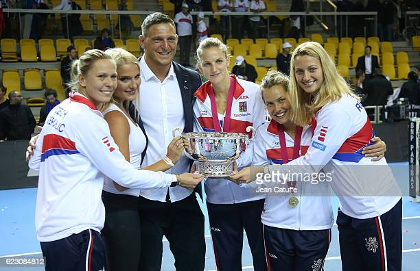 Olympic gold medalist in Rio Lukas Krpalek of Czech Republic in judo and his wife Eva Krpalekova pose with winners of the the Fed Cup Lucie Hradecka...