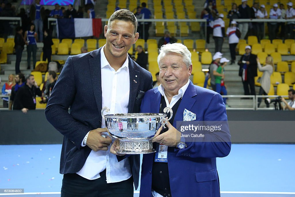 Olympic gold medalist in Rio Lukas Krpalek of Czech Republic in judo and Miroslav Cernosek pose with the trophy following the 2016 Fed Cup Final between France and Czech Republic at Rhenus Sport arena on November 13, 2016 in Strasbourg, France.