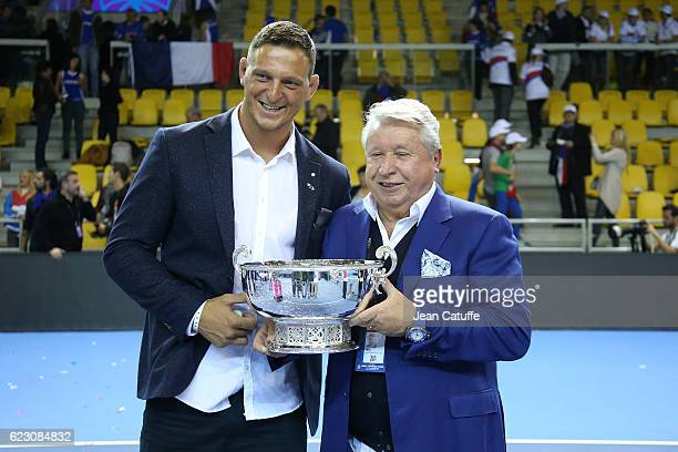 Olympic gold medalist in Rio Lukas Krpalek of Czech Republic in judo and Miroslav Cernosek pose with the trophy following the 2016 Fed Cup Final...