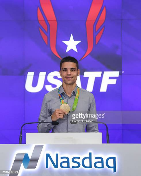 Olympic gold medalist in track and field Matthew Centrowitz, Jr. Poses before ringing the Nasdaq closing bell at the NASDAQ Marketsite on September...