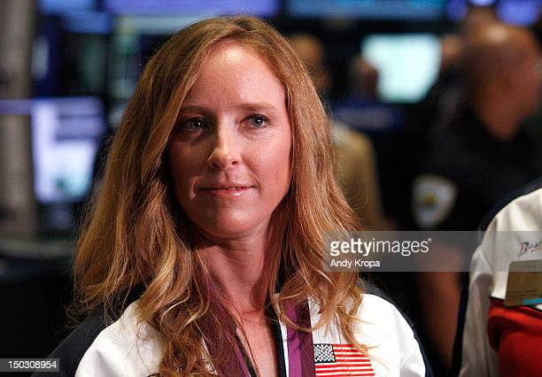 S Olympic gold medalist in Women's Rowing Mary Whipple rings the opening bell at the New York Stock Exchange on August 15 2012 in New York City