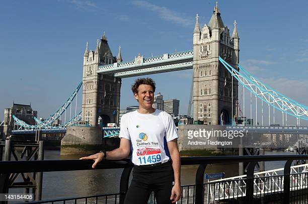 Olympic gold medalist James Cracknell poses in front of Tower Bridge during a photocall ahead of the Virgin London Marathon 2012 on April 20 2012 in...