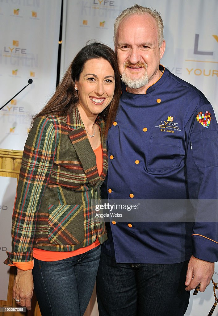Olympic gold medalist Janet Evans and celebrity chef Art Smith attend the grand opening of LYFE Kitchen restaurant on March 8, 2013 in Culver City, California.