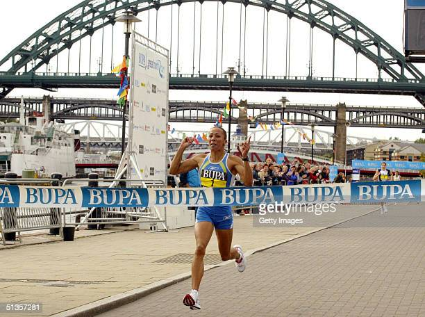 Olympic Gold medalist Kelly Holmes of the United Kingdom crosses the finish line to win The Great North Run September 25 2004 in Newcastle England